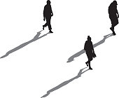 Vector illustration of an above view of three people walking with long shadows.