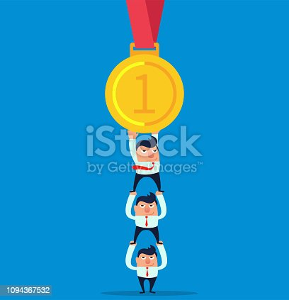 Three people work together to pick up the gold medal