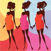 Three pregnant females with vibrant pattern background.