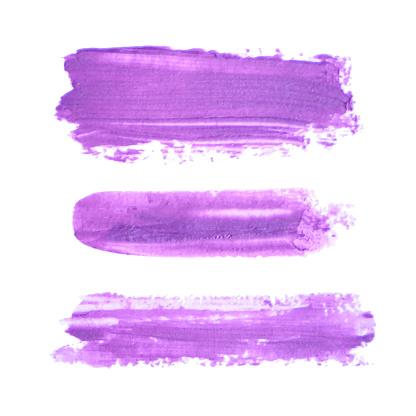 Three realistic purple lipstick smears