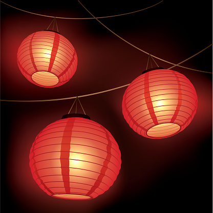 Three red paper lanterns hanging from wires