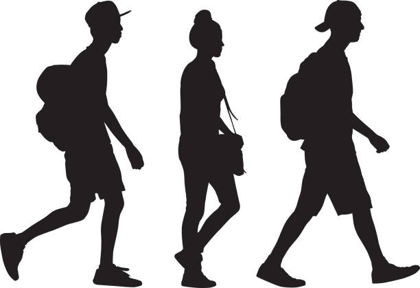 Three Teens Walking Silhouette Vector silhouette of three teens walking together in a row. students stock illustrations