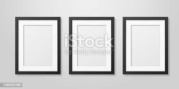 Three Vector Realistic Mofern Interior Black Blank Vertical A4 Wooden Poster Picture Frame Set Closeup on White Wall Mock-up. Empty Poster Frames Design Template for Mockup, Presentation.