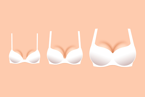 Three white brassieres with cups of different sizes