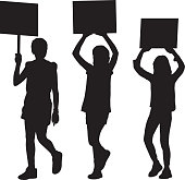 Vector silhouette of three young girls protesting.