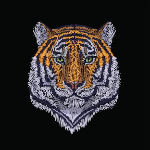 タイガーは、高貴な見つめて頭します。正面の刺繍パッチのステッカー。オレンジ ストライプ黒野生動物ステッチ テクスチャ絵柄はプリント。ジャングルのロゴのベクトル図 - 花のボーダー点のイラスト素材/クリップアート素材/マンガ素材/アイコン素材