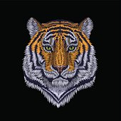 Tiger head noble staring. Front view embroidery patch sticker. Orange striped black wild animal stitch texture textile print. Jungle logo vector illustration