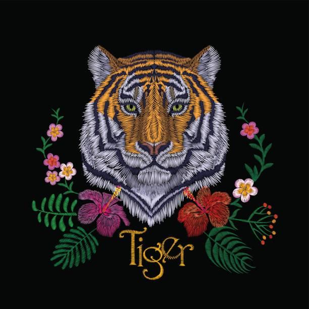タイガー ヘッドの熱帯花。正面の刺繍パッチのステッカー。オレンジ ストライプ黒野生動物ステッチ テクスチャ絵柄はプリント。ジャングルのロゴのベクトル図 - 花のボーダー点のイラスト素材/クリップアート素材/マンガ素材/アイコン素材