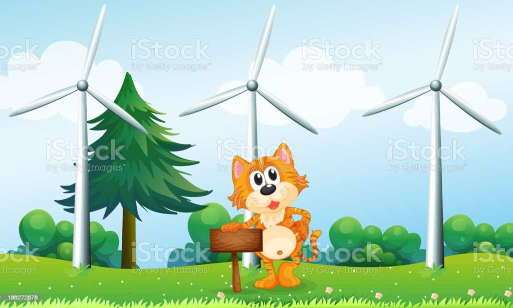 tiger holding an empty wooden signboard near the windmills