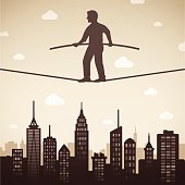 Man on a tight rope walking above a city with space for copy. EPS 10 file. Transparency effects used on highlight elements.