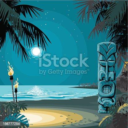 Tiki totem on a desert beach by the moonlight.