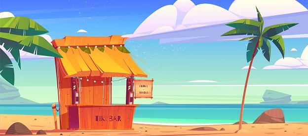 Tiki bar with tribal masks on summer beach