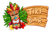 Tiki tribal wooden mask. Hawaiian traditional character. Hawaii bar symbol. Tradition cartoon sculpture. Wooden banner. Isolated white background. EPS10 vector illustration.