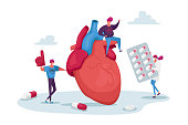 istock Tiny Characters at Huge Heart Cholesterol Diagnose. Chemical Laboratory Science, Woman Hold Pharmacy Medicine Blister 1269730871