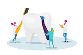 istock Tiny Dentists Characters Checking Huge Tooth for Caries Hole in Plaque. Doctors Hold Stomatology Tools Drill and Brush 1274274015