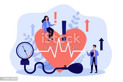 istock Tiny doctors examining heart health flat vector illustration 1295615803