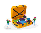 istock Tiny Girls Take Out Traveling Clothes or Accessories from Huge Suitcase after Vacation Trip, Summer Time Leisure Journey 1263724084