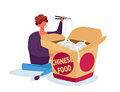 istock Tiny Man Holding Wooden Chopsticks in Chinese Fast Food Restaurant Sitting near Huge Takeaway Wok Box Eating Noodles 1287092842