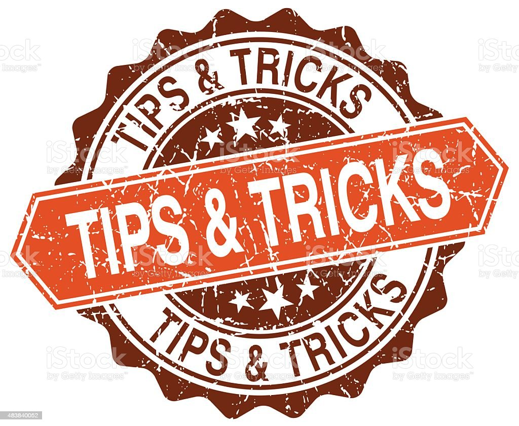 tips & tricks orange round grunge stamp on white vector art illustration