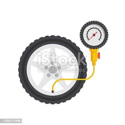 istock Tire pressure gauge. Checking tire pressure. Gauge, manometer 1335474490