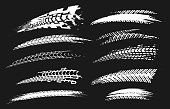 Motorcycle tire tracks vector illustration. Grunge automotive element useful for poster, print, flyer, book, booklet, brochure and leaflet design. Editable graphic set in white color isolated on a black background.