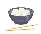 Tofu pieces in black bowl and chopsticks isolated on white background. Vector illustration of bean curd cubes in cartoon simple flat style.