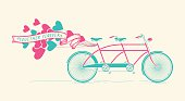 Together forever - vintage tandem bicycle with hearts balloons