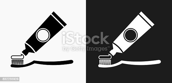 istock Tooth Brush and Paste Icon on Black and White Vector Backgrounds 832255926