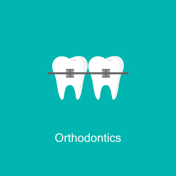 tooth with braces icon. - orthodontist stock illustrations, clip art, cartoons, & icons