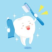 tooth with toothbrush and toothpaste
