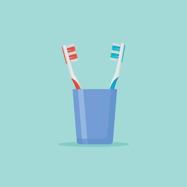 Toothbrushes in glass flat style icon. Vector illustration. vector art illustration