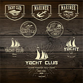 Top quality badges logos and labels for any use. Company corporate logo element design. On wooden background texture