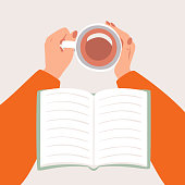 Top view female hands holding a Cup of coffee or tea and an open book is on hands. Cozy autumn concept in flat cartoon style.