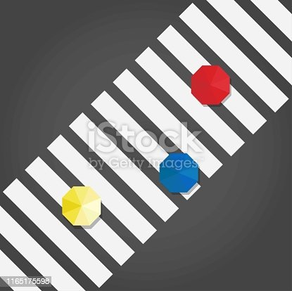Top view of a three umbrelas: yellow, blue and red on a pedestrian crosswalk, vector