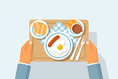 istock Top view of breakfast on wooden tray 1055140382