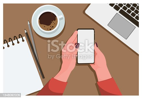 istock Top view of work table at workplace by human hands 1348092026