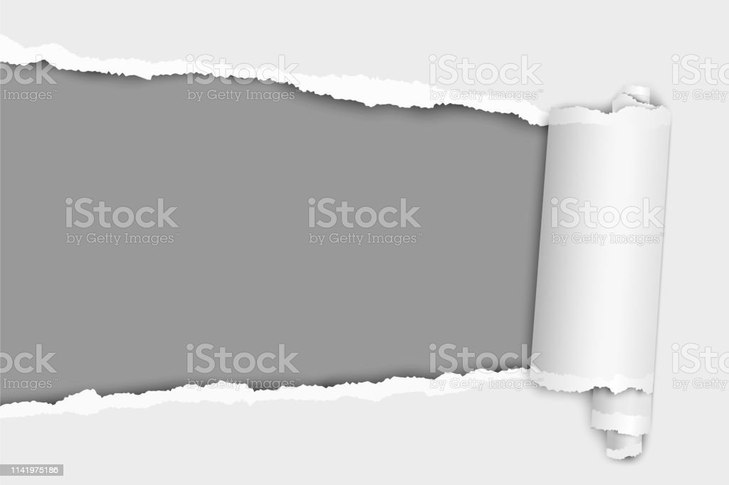 Torn elongated hole from left to right in white paper with paper...
