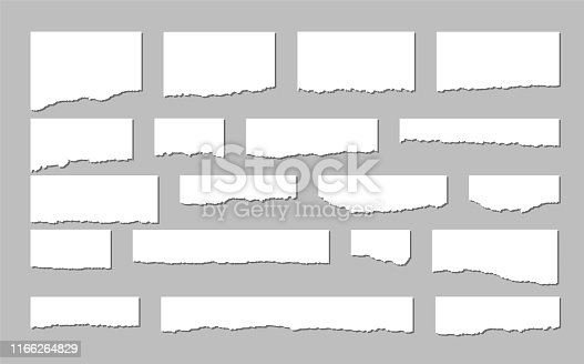 Torn sheets of paper. A set of torn paper on a dark background. Vector illustration.