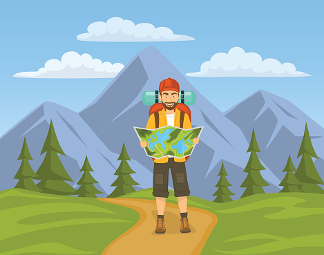 tourist hiking in mountains. man holding, looking at map.