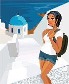 A lovely young woman with her backpack surveying the Santorini view in the sunshine