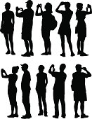 A collection of tourists in silhouette.
