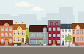 Street with houses in different architectural styles and colours. Lots of details.