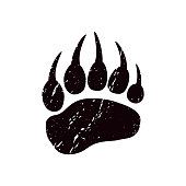 A trace a bear. White silhouette of paw on a black background. Vector. The imprint of a bear s foot. Logo of the footprint.