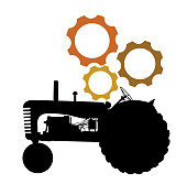 Old fashion tractor in silhouette