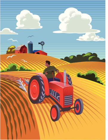 Landscape with old style tractor ploughing field