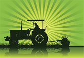 A tractor in silhouette on a farm. Hi-res Jpeg included..
