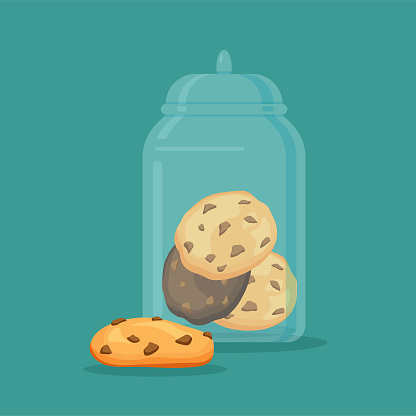 Traditional chip cookies with chocolate in the glass jar or vase.