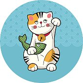 Traditional japanese lucky cat with fish. Maneki-neko.