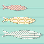 Traditional Portuguese icon. Colored sardines with geometric chevron patterns on wooden background. Fish vector illustration