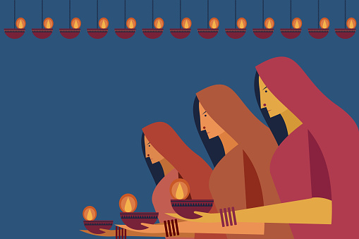 Traditional women holding oil lamps in their hands. Concept for the festival Diwali